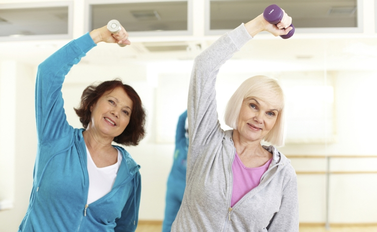 two senior ladies working out with dumbells