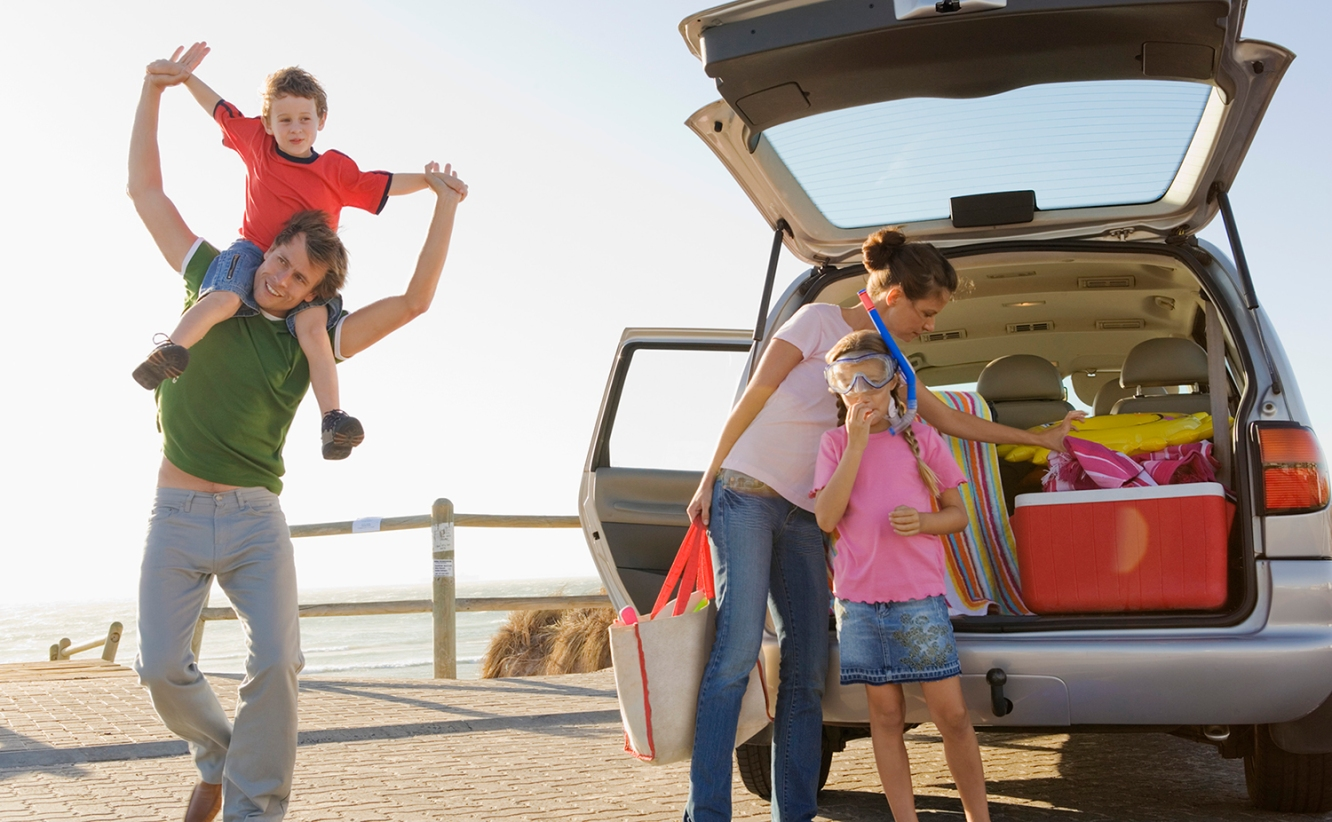 young family packing for summer vacation