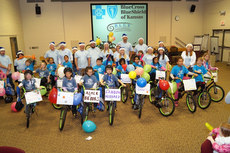 Blue Cross Blue Shield of Kansas bike giveaway to Boys & Girls Clubs of Topeka